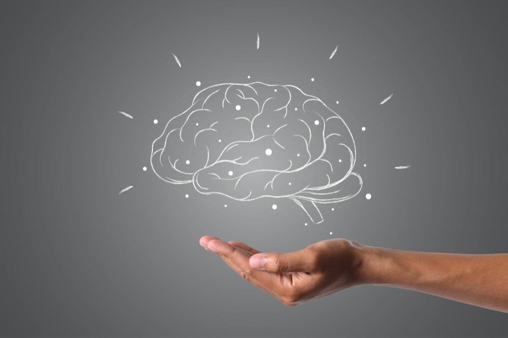 Cerveau dessiné en fil de fer blanc sur fond gris